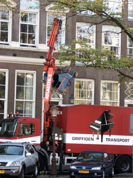 I found this interesting....hoisting a grand piano with a crane