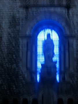 Closeup of the Church of the Blue Neon Christ