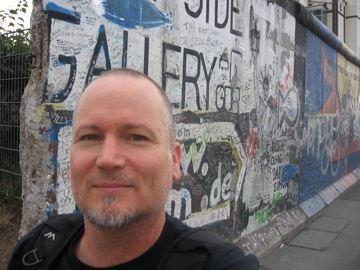 At the remants of the wall in Friedrichshain.